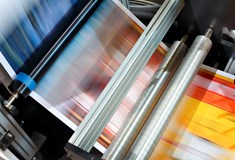 image of blurred coloured paper running through a machine