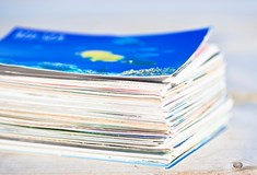 close up of a large stack of colourful paper