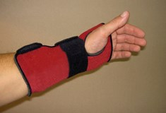 extended fore arm with red and black wrist support